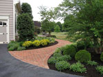 Brick Sidewalk and Oval Planting Beds